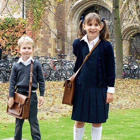 HANDOUT Julie Deane's kids modeling the first satchels