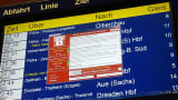 A window announcing the encryption of data including a requirement to pay appears on an electronic timetable display at the railway station in Chemnitz, eastern Germany, on May 12, 2017.