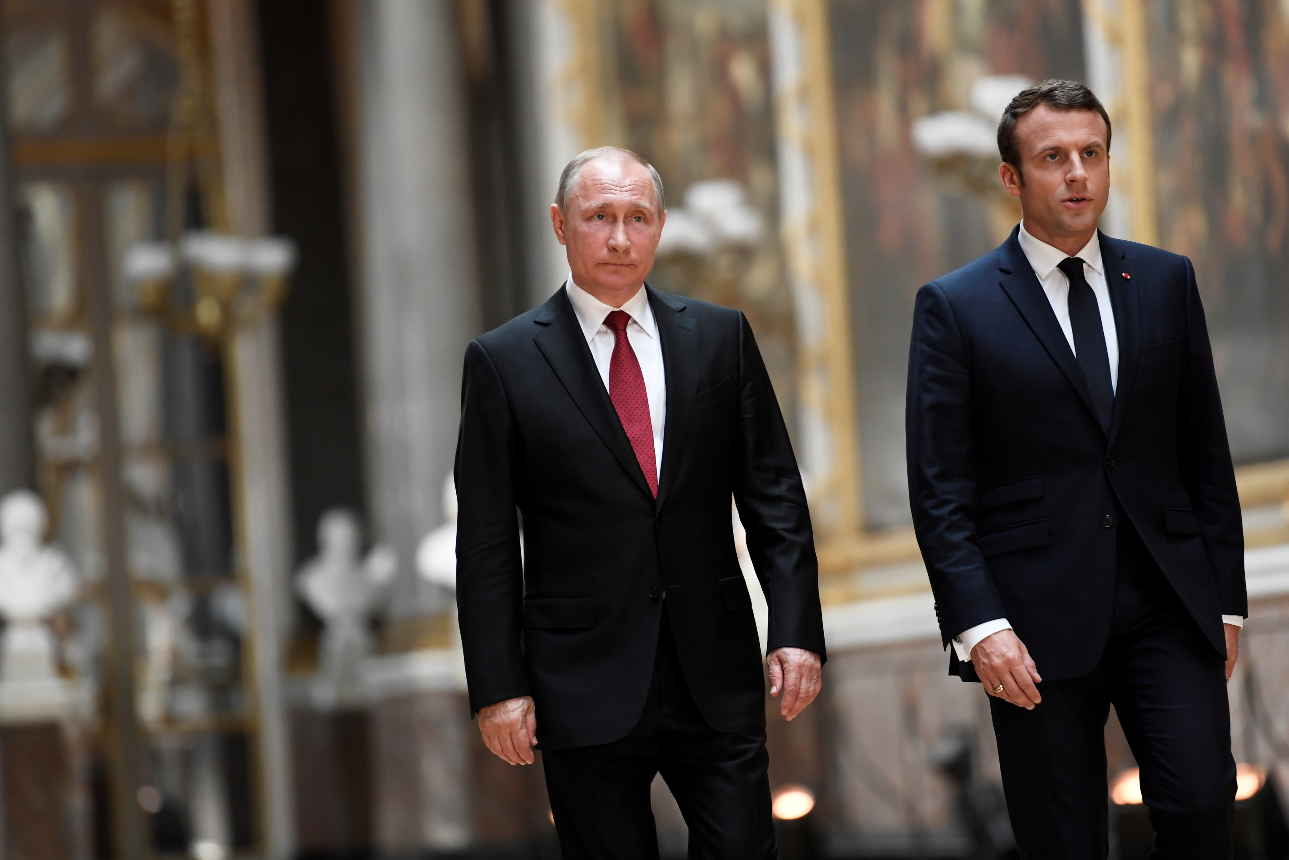 French President Emmanuel Macron, with Russian President Vladimir Putin, in Versailles on May 29, 2017.