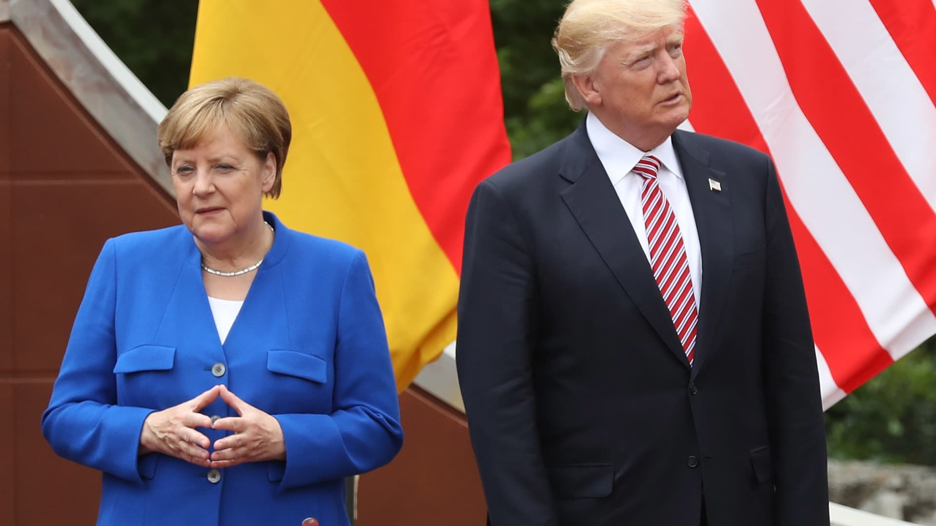German Chancellor Angela Merkel and U.S. President Donald Trump arrive for a group photo at a G7 summit on May 26, 2017 in Taormina, Italy.