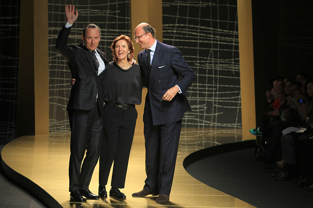 Gildo Zegna, Anna Zegna and Paolo Zegna walk the runway during the Ermenegildo Zegna show during Milan Fashion Week.