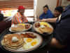 Denny's waitress delivers free Grand Slam breakfasts to customers