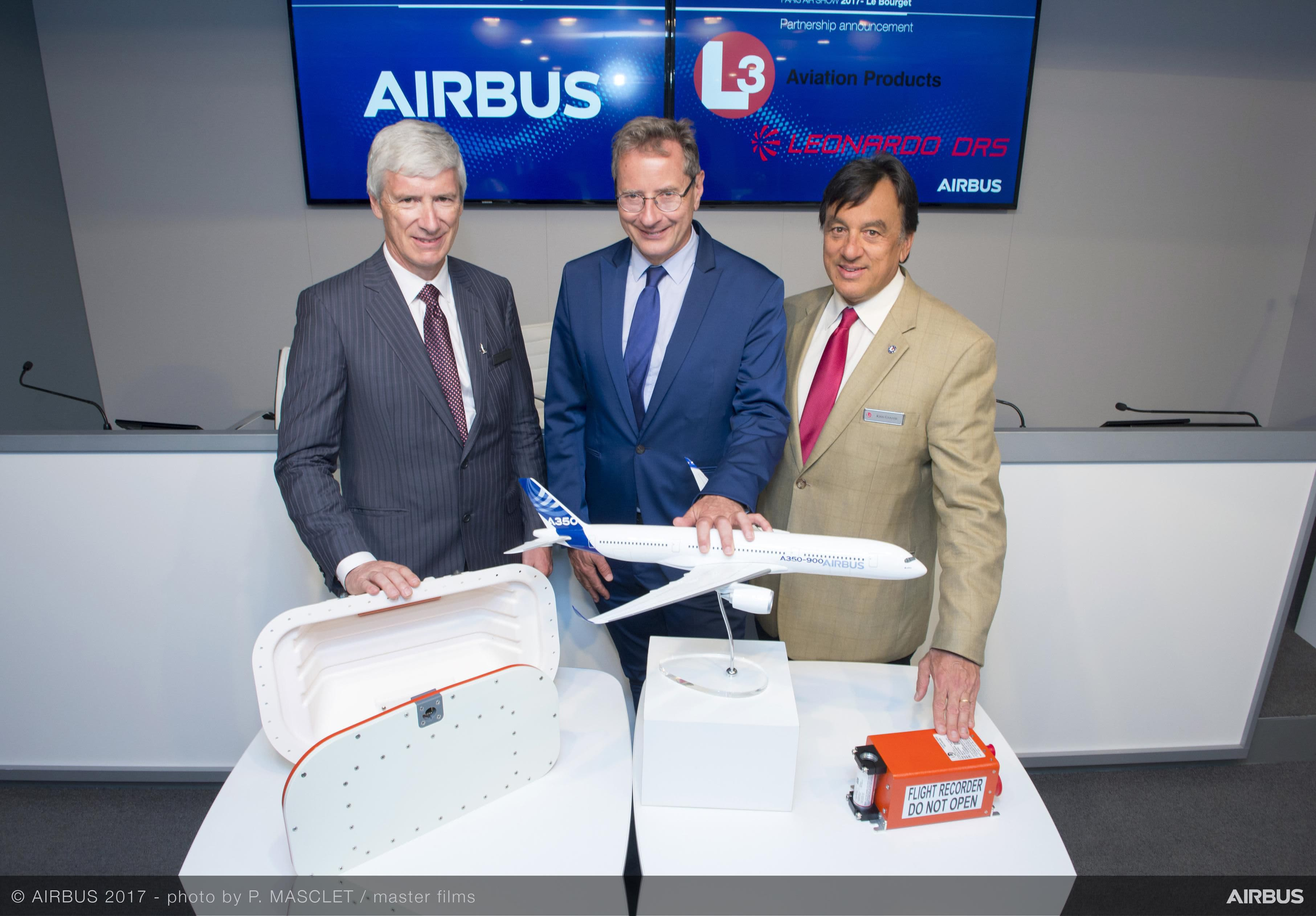 Charles Champion (middle), executive vice president of engineering at Airbus Commercial Aircraft; Martin Munro (L), Canada vice president at DRS technologies; and Kris Ganase (R), president of aviation products and security at L3 Communications show off a new ejectable flight recorder.