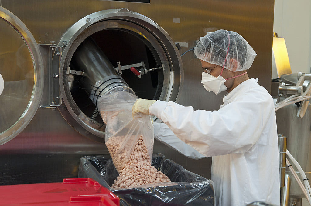 An employee collects newly-manufactured pills at the tablet production plant at Teva Pharmaceutical Industries headquarters in Jerusalem, Israel.