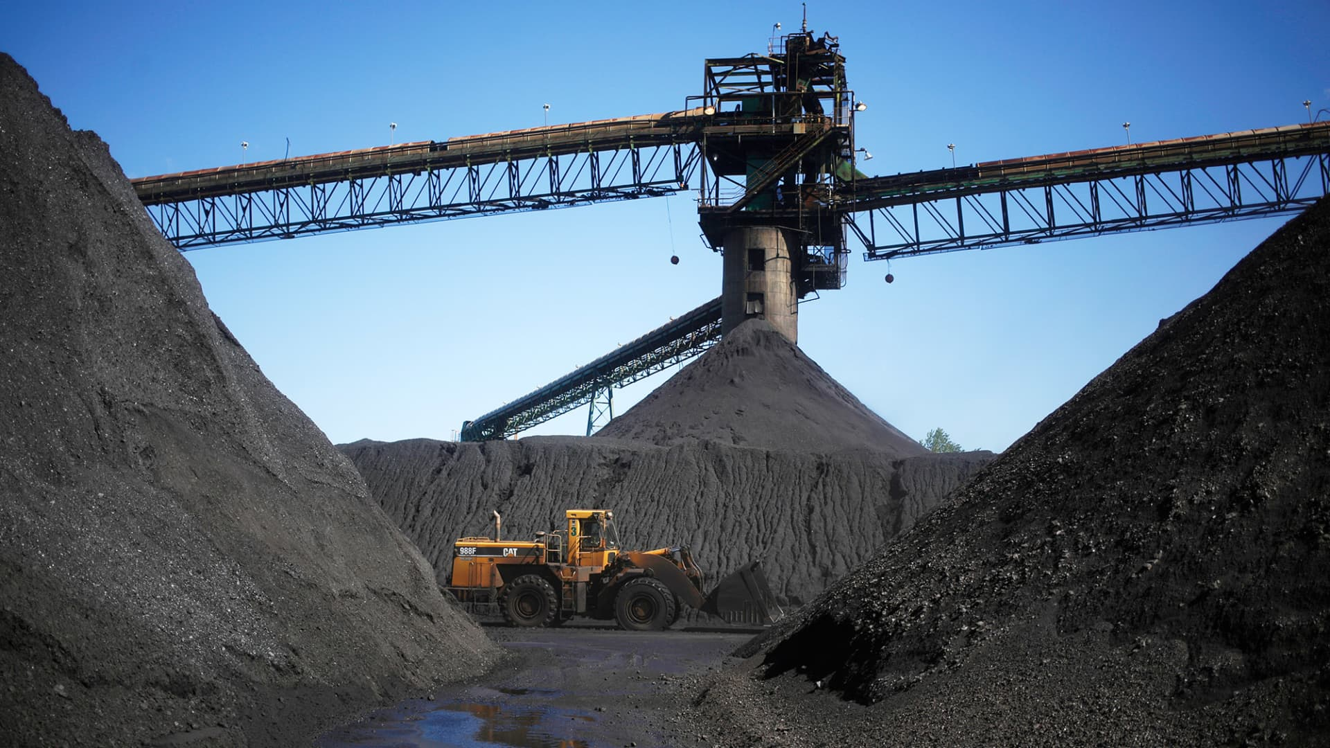 Coal mounds sit beneath coaling towers at the SunCoke Energy Partners LP Ceredo Terminal in Ceredo, West Virginia.