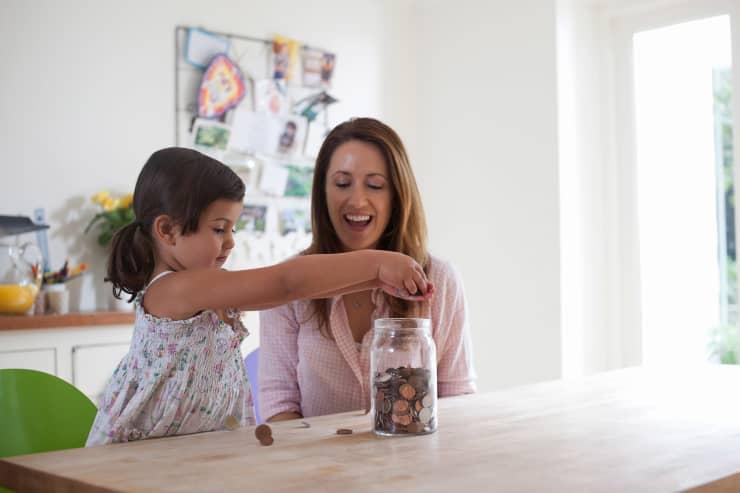 Premium: saving money mother child money jar investing financial education