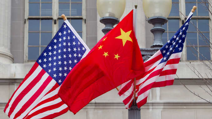 Flags of the U.S. and China fly along Pennsylvania Avenue in Washington, D.C.