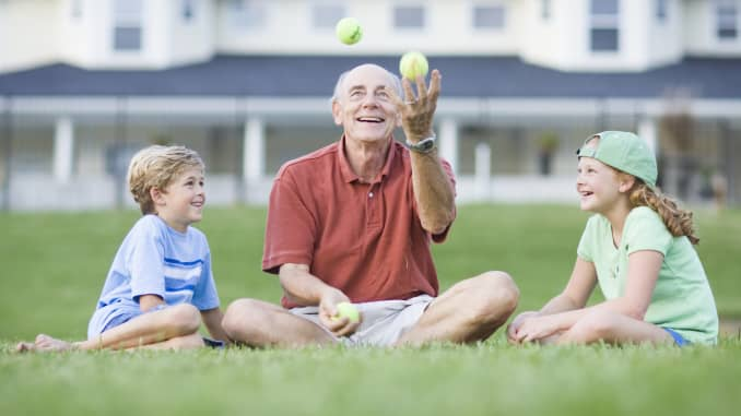 Premium: Grandfather juggling tennis balls