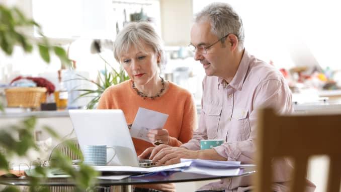 Premium: Older couple assessing retirement savings