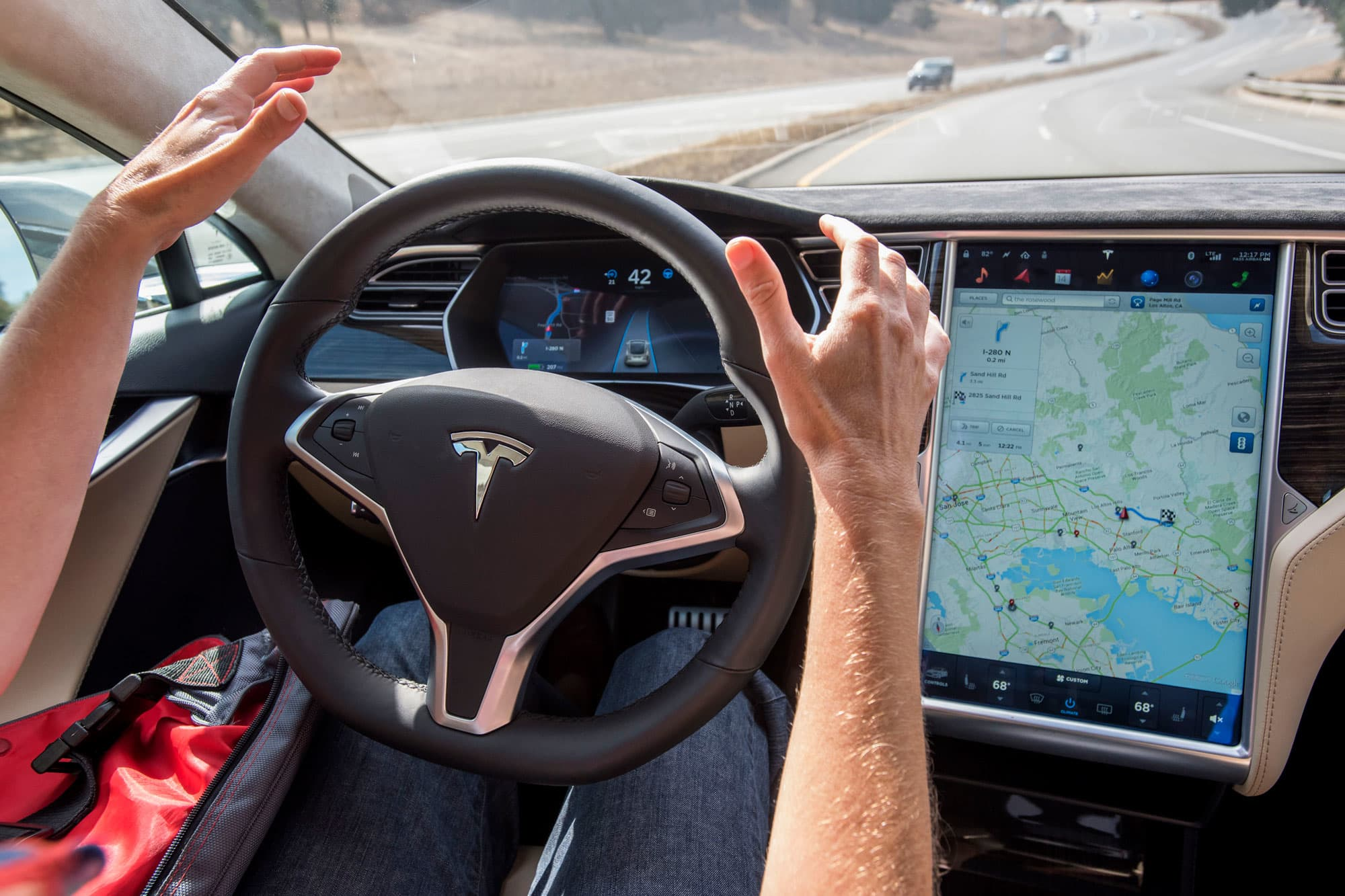 A federal agency warns Tesla tests unfinished driverless tech on its users