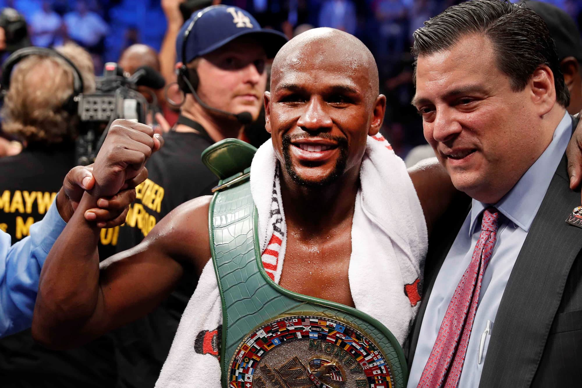 Floyd Mayweather Jr. celebrates with the belt and President of the WBC Mauricio Sulaiman after defeating Conor McGregor, August 26, 2017.