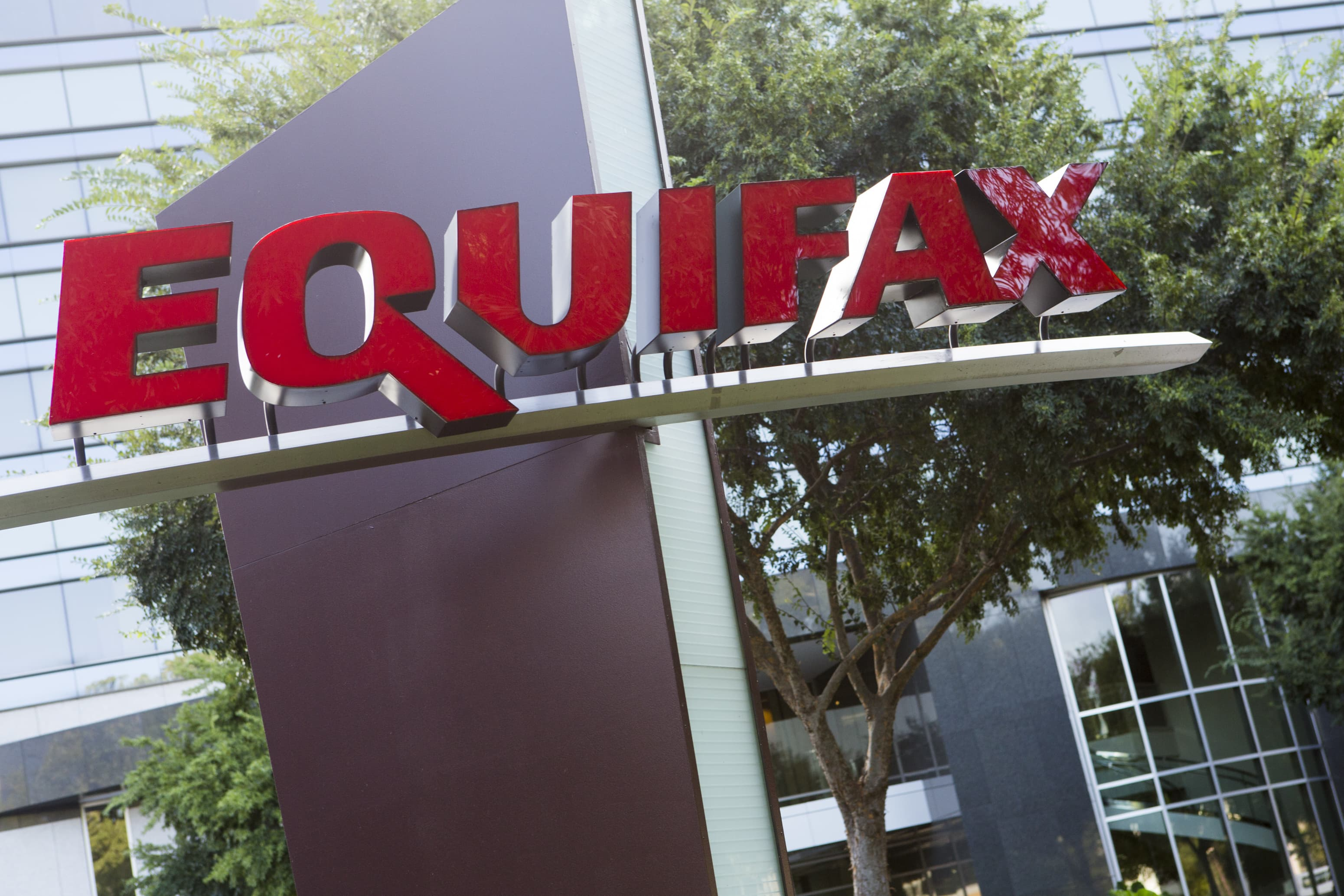 A logo sign outside of the headquarters of the consumer credit rating firm Equifax in Atlanta, Georgia.