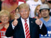President Donald Trump gives a thumbs-up to supporters at the Phoenix Convention Center during a rally on August 22, 2017, in Arizona.