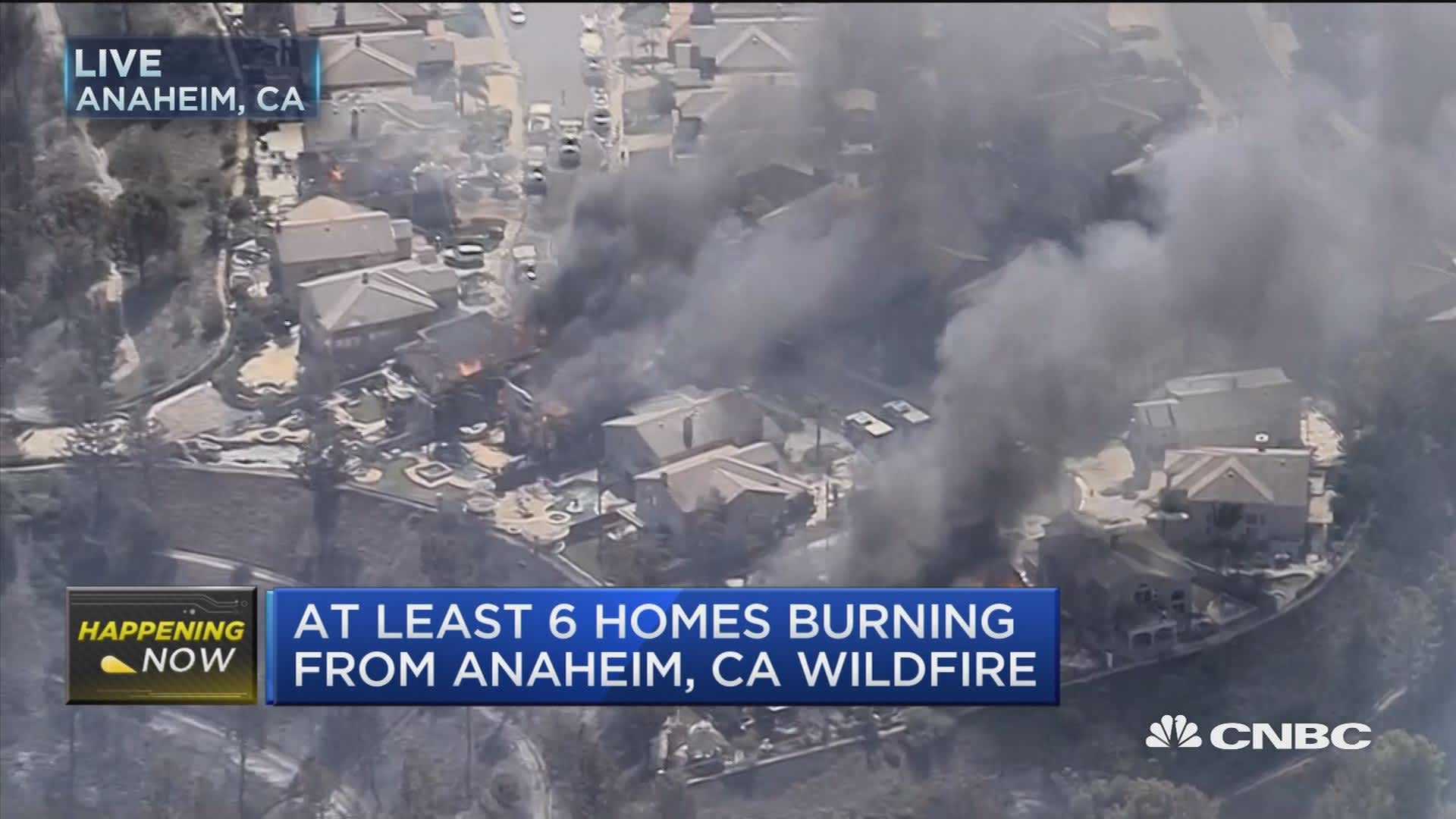 At least six homes burning as wildfires break out in Anaheim, California