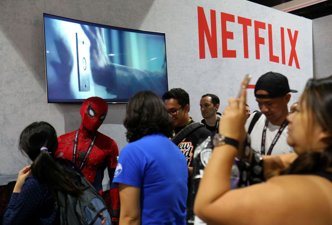 Dow falls in choppy session, but Netflix leads tech winners