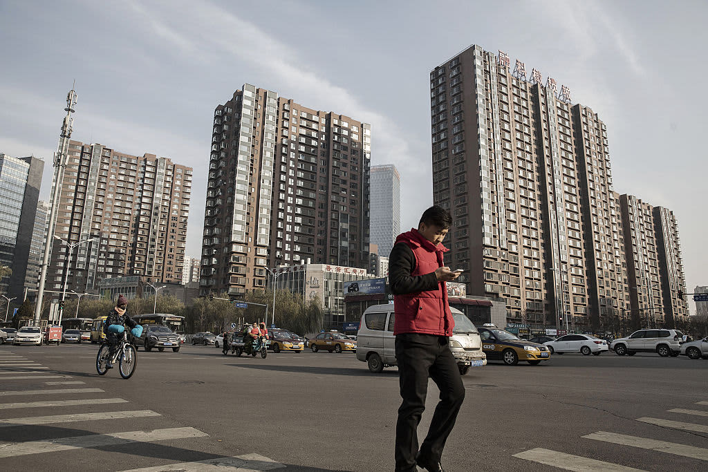 China's major cities drag on new home prices in Oct.