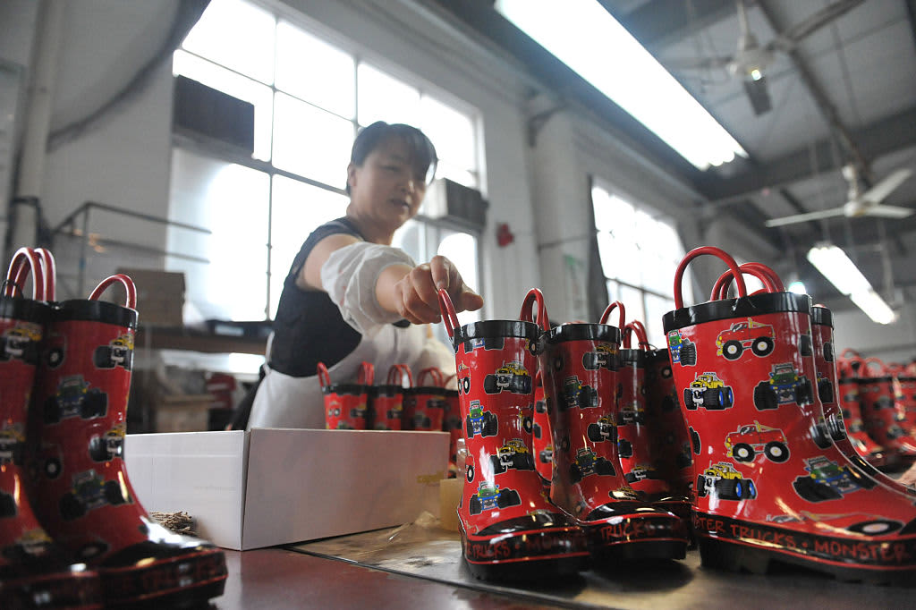 A private survey shows China's manufacturing activity expanded in October, better than expected