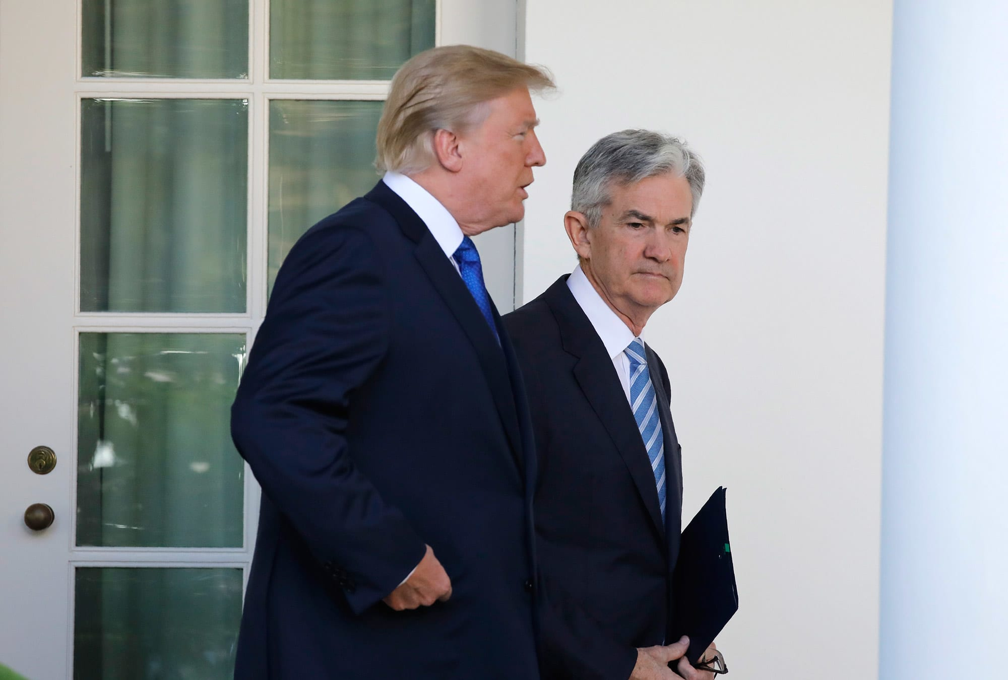 Trump says 'devalued' currencies put US at a disadvantage and the Fed doesn't have a 'clue'