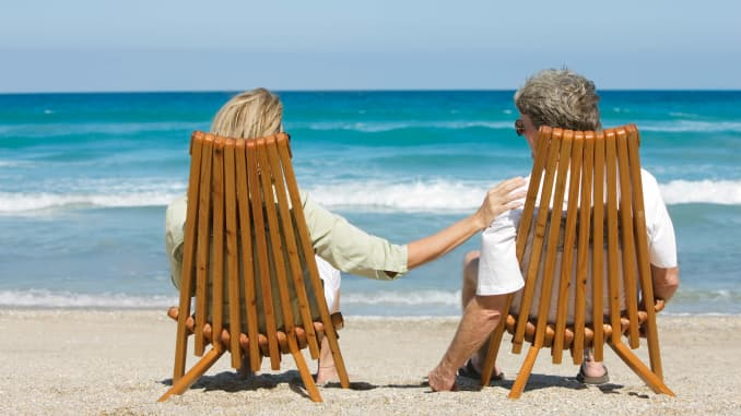 Premium: Couple on beach early retirement