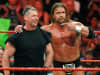 World Wrestling Entertainment Inc. Chairman Vince McMahon (L) and wrestler Triple H appear in the ring during the WWE Monday Night Raw show at the Thomas & Mack Center August 24, 2009