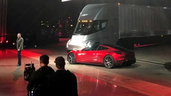 Tesla CEO Elon Musk shows off the Tesla Semi as he unveils the company's new electric semi truck during a presentation in Hawthorne, California, U.S., November 16, 2017.
