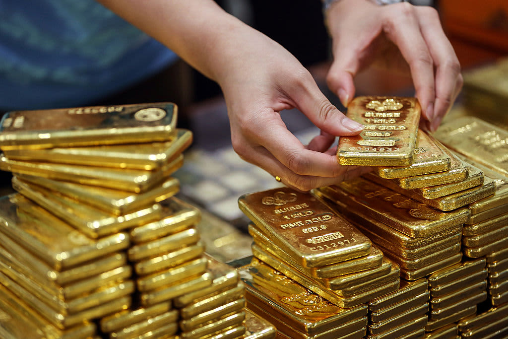Gold slips as a partial US-China trade deal lifts risk appetite