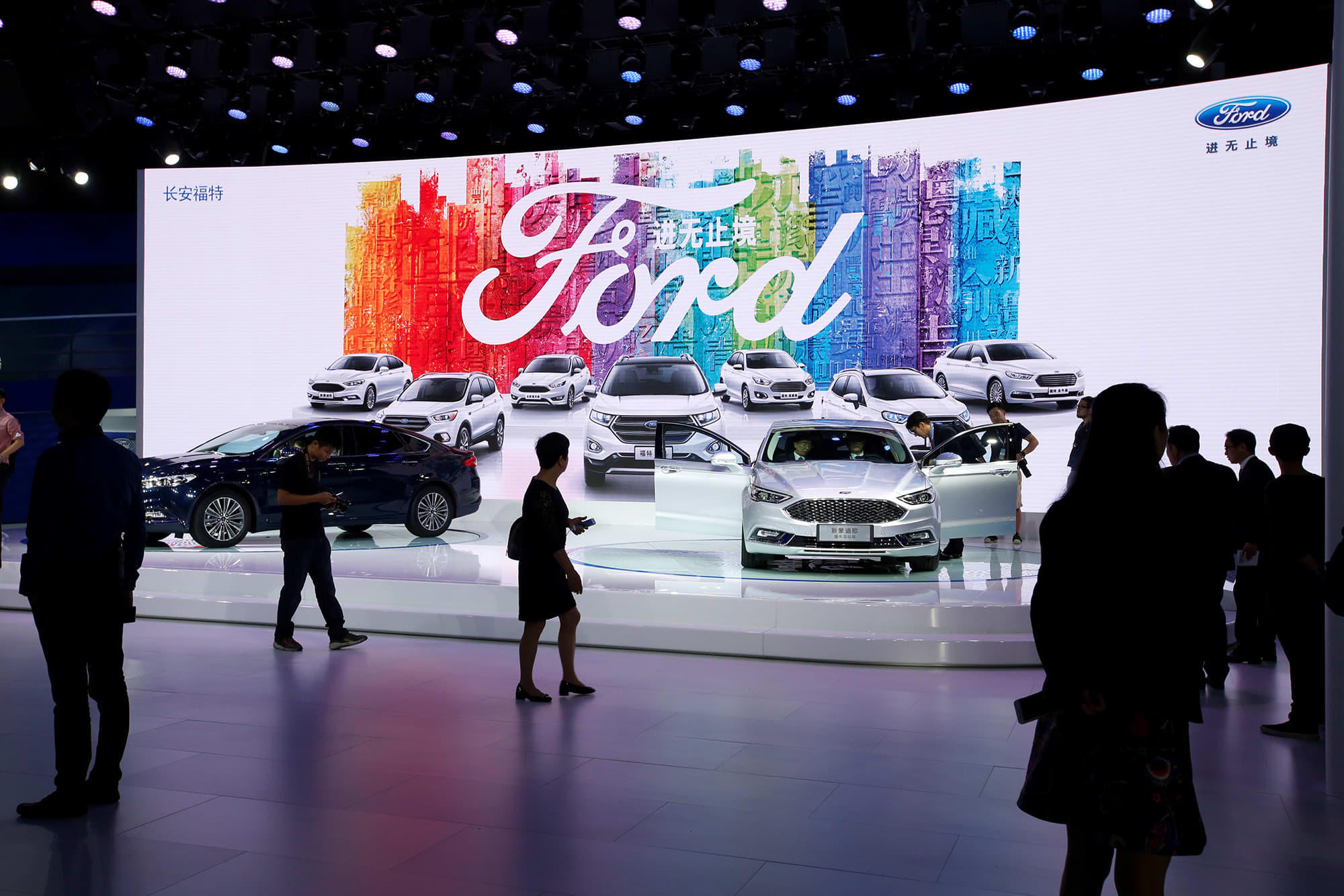 Visitors look at Ford models at Auto Guangzhou in Guangzhou, China November 17, 2017.