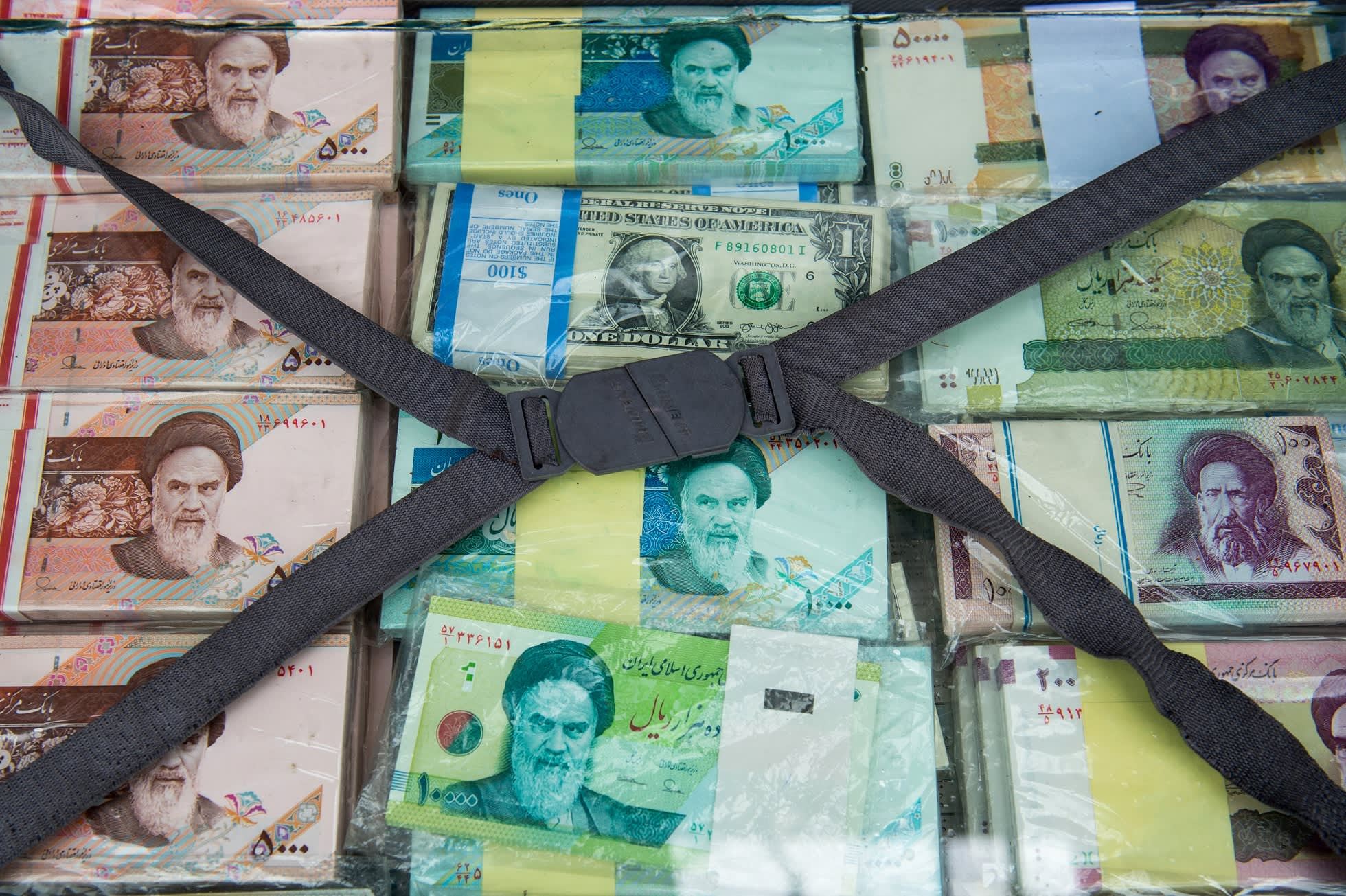 Iran looks to slash four zeroes from its spiraling currency