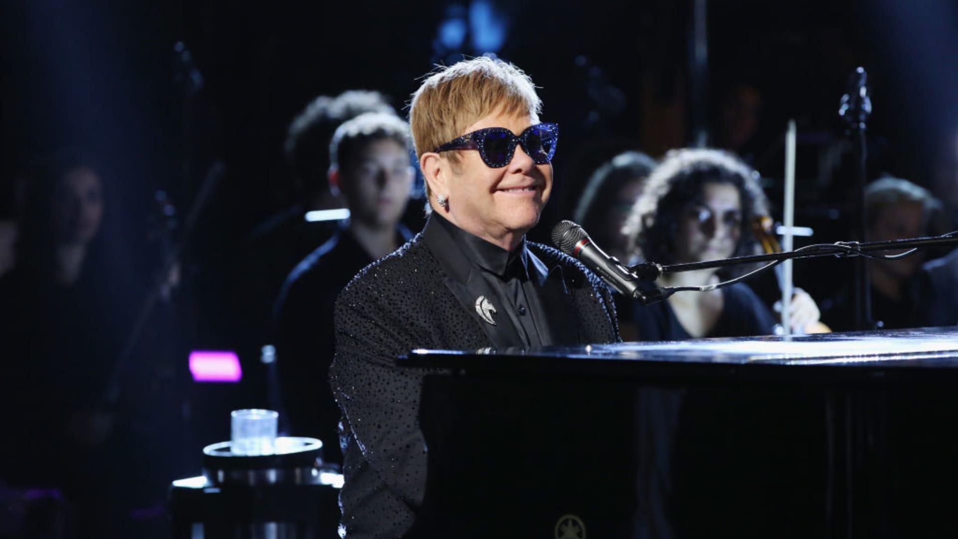 Elton John performs at the Andrea Bocelli show