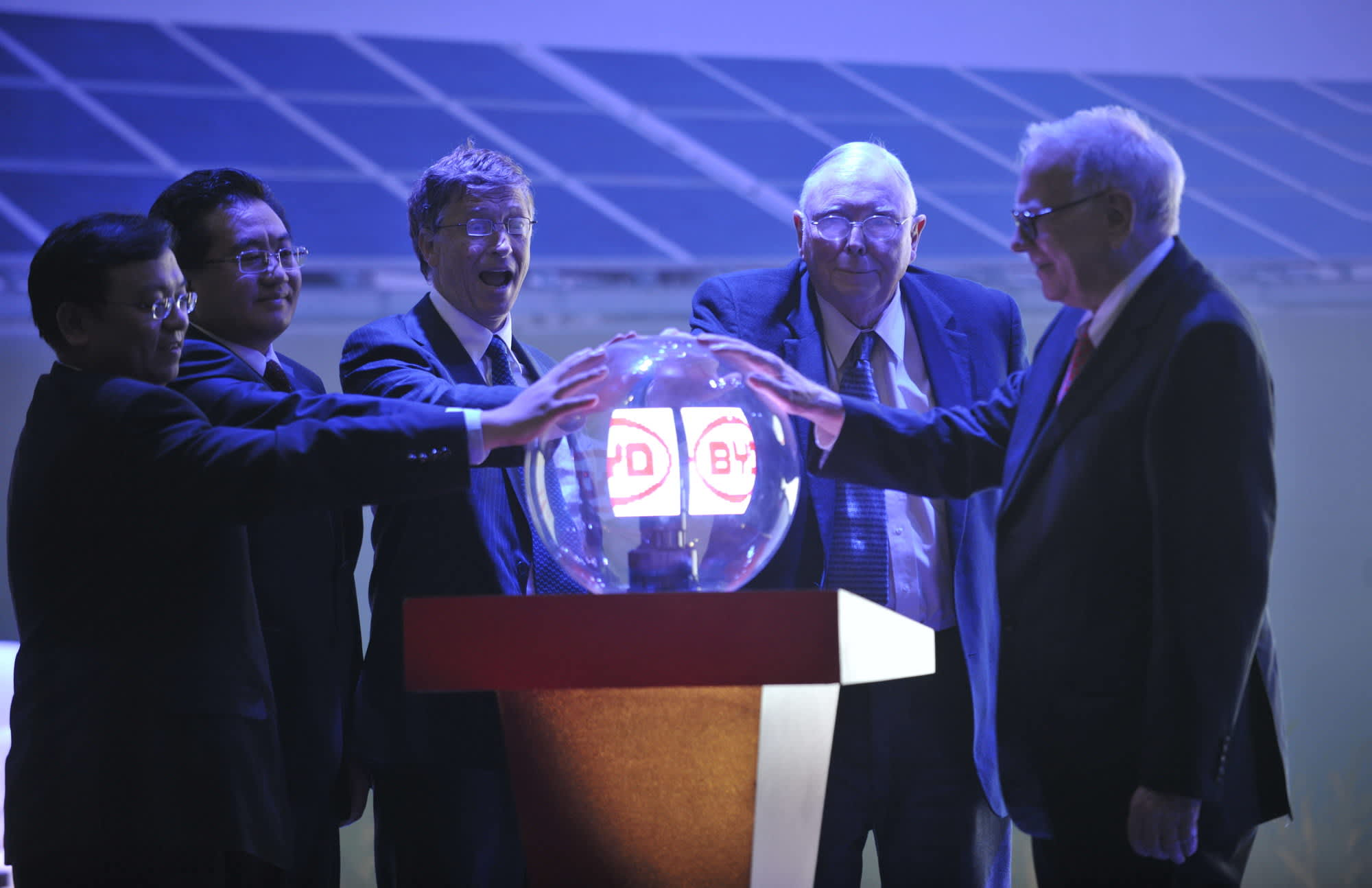 Warren Buffett, Charlie Munger and Bill Gates attend a product launch in Beijing, China for BYD, the electric battery, car, and solar energy company in which Munger long ago led an investment for Berkshire Hathaway.