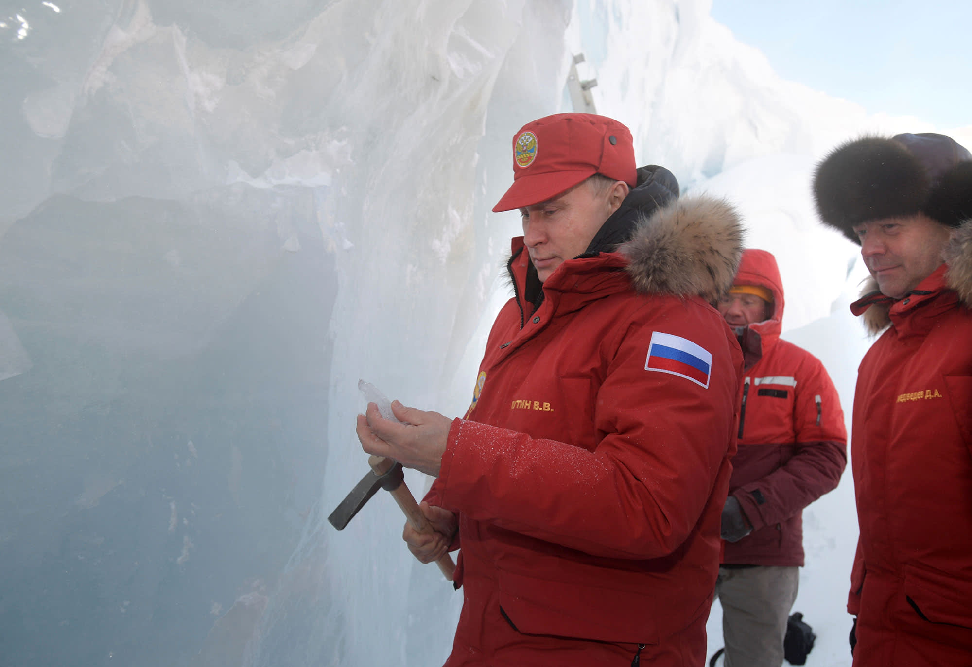Russian President Vladimir Putin and Prime Minister Dmitry Medvedev visit the cave of Arctic Pilots Glacier in Alexandra Land in remote Arctic islands of Franz Josef Land, Russia March 29, 2017.