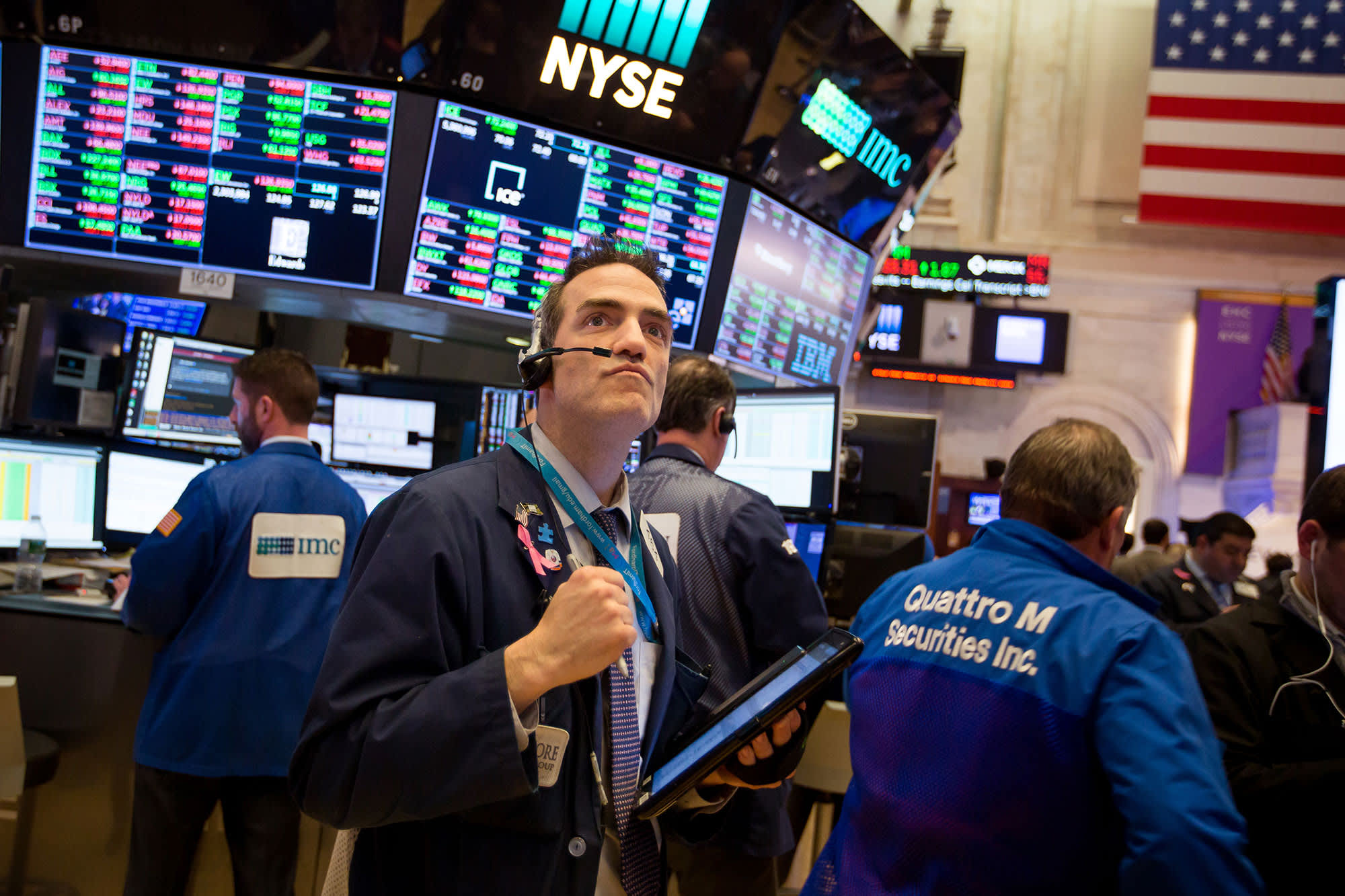 Dow jumps more than 200 points, closes above 27,000 for the first time since July