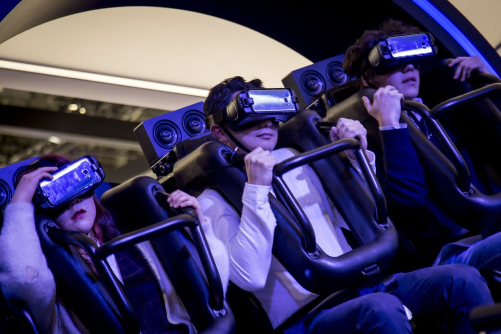 Visitors examine the new Samsung's VR (Virtual Reality) devices during the Mobile World Congress 2017 in Barcelona, Spain on February 27, 2017.