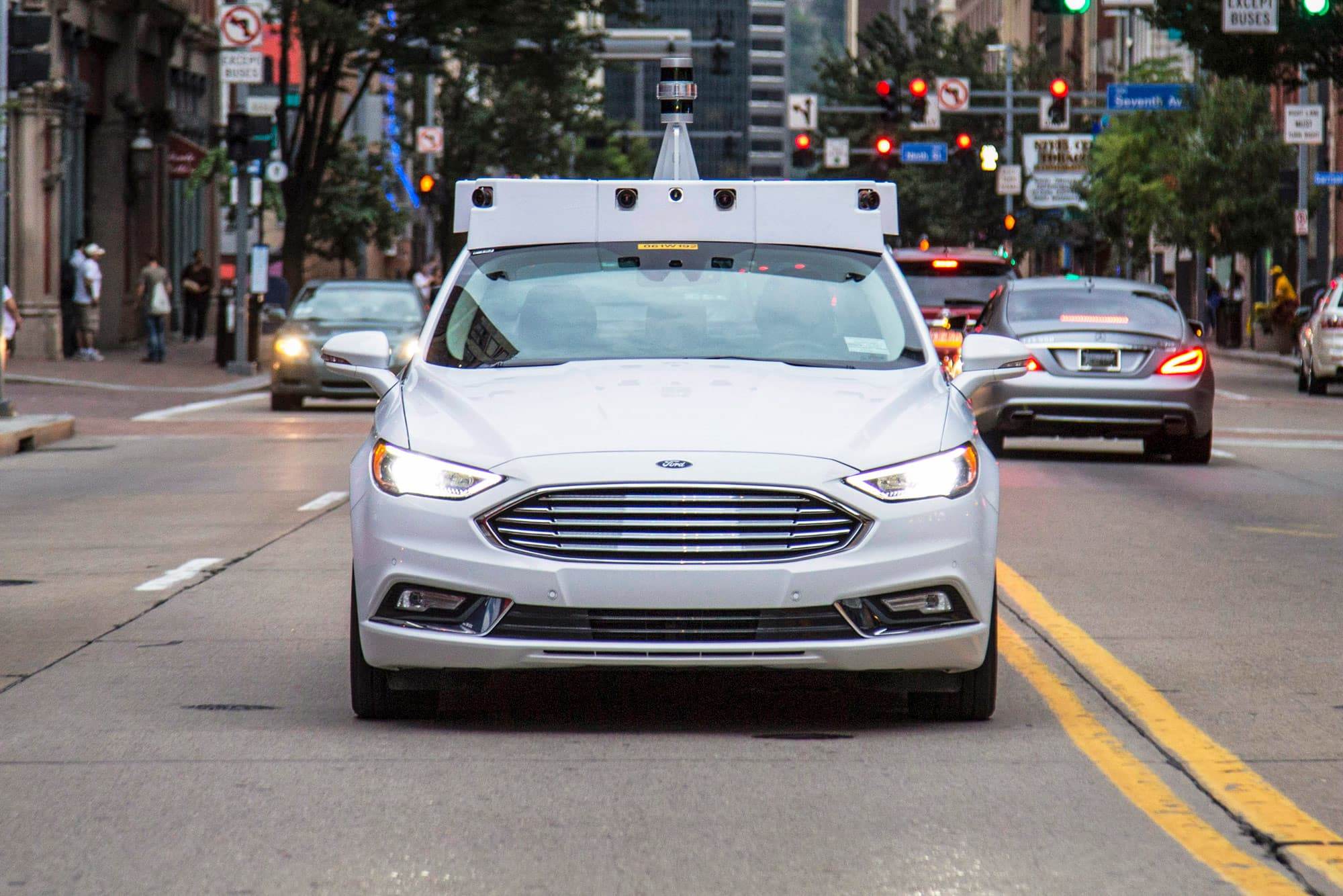 Ford teams with Domino's to test deliveries by autonomous
