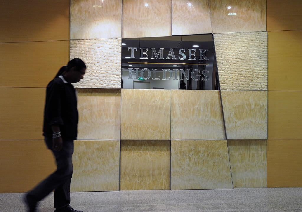 Multibillion-dollar Singapore investing giant Temasek says its returns have taken a hit