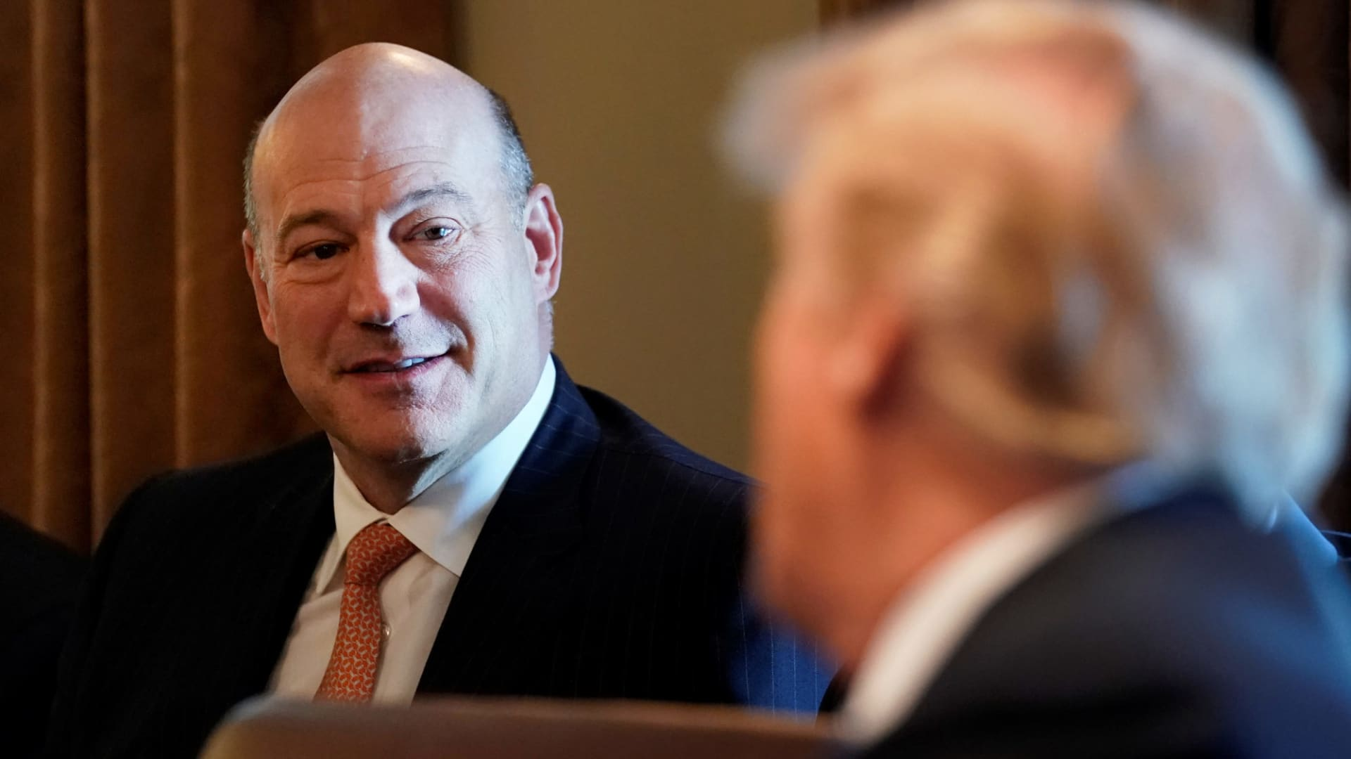 President Donald Trump praises departing economic adviser Gary Cohn (L) during a Cabinet meeting at the White House, Washington, March 8, 2018.