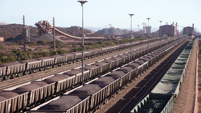 Iron ore on railway wagons at Salanaha Bay Terminal in South Africa.