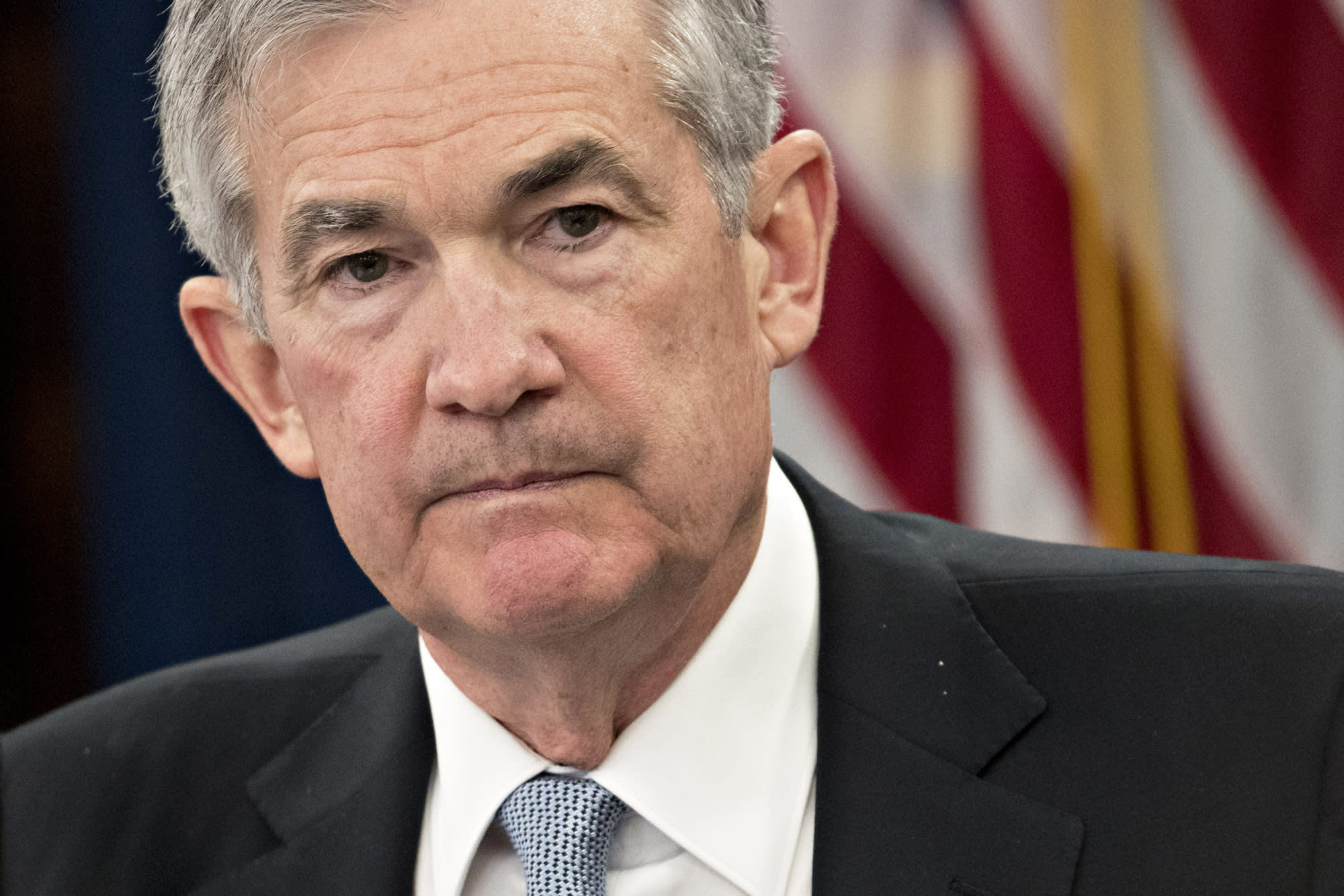 Fed not moving off sidelines unless inflation heats up and stays there, Powell emphasizes