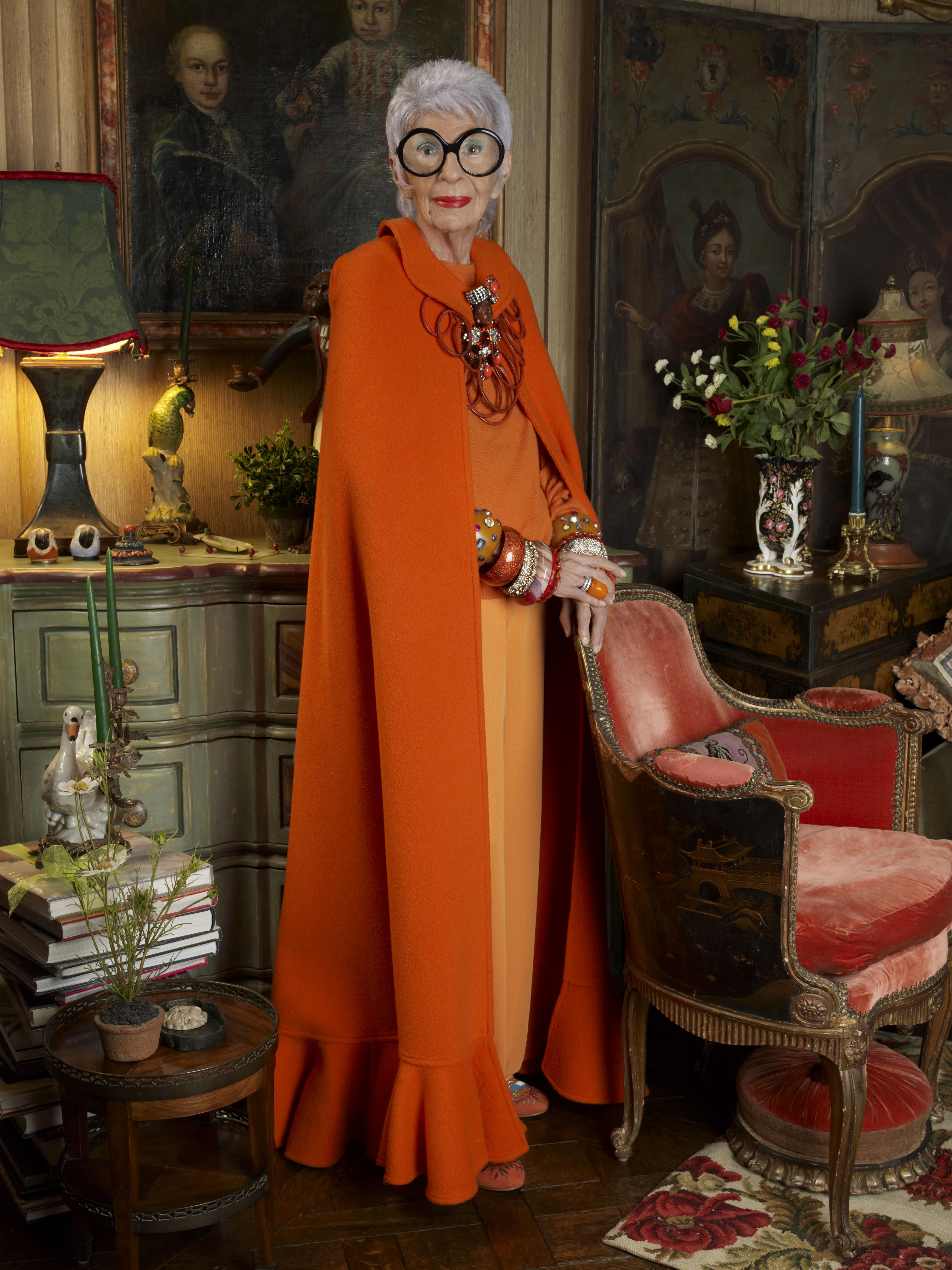 HANDOUT Iris Apfel standing tall in orange