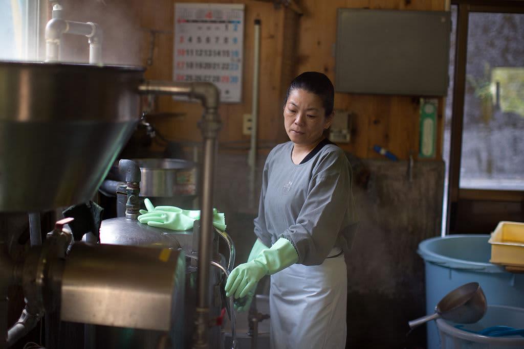 A woman works in a small tofu factory in Ochiai, Miyoshi, Japan.