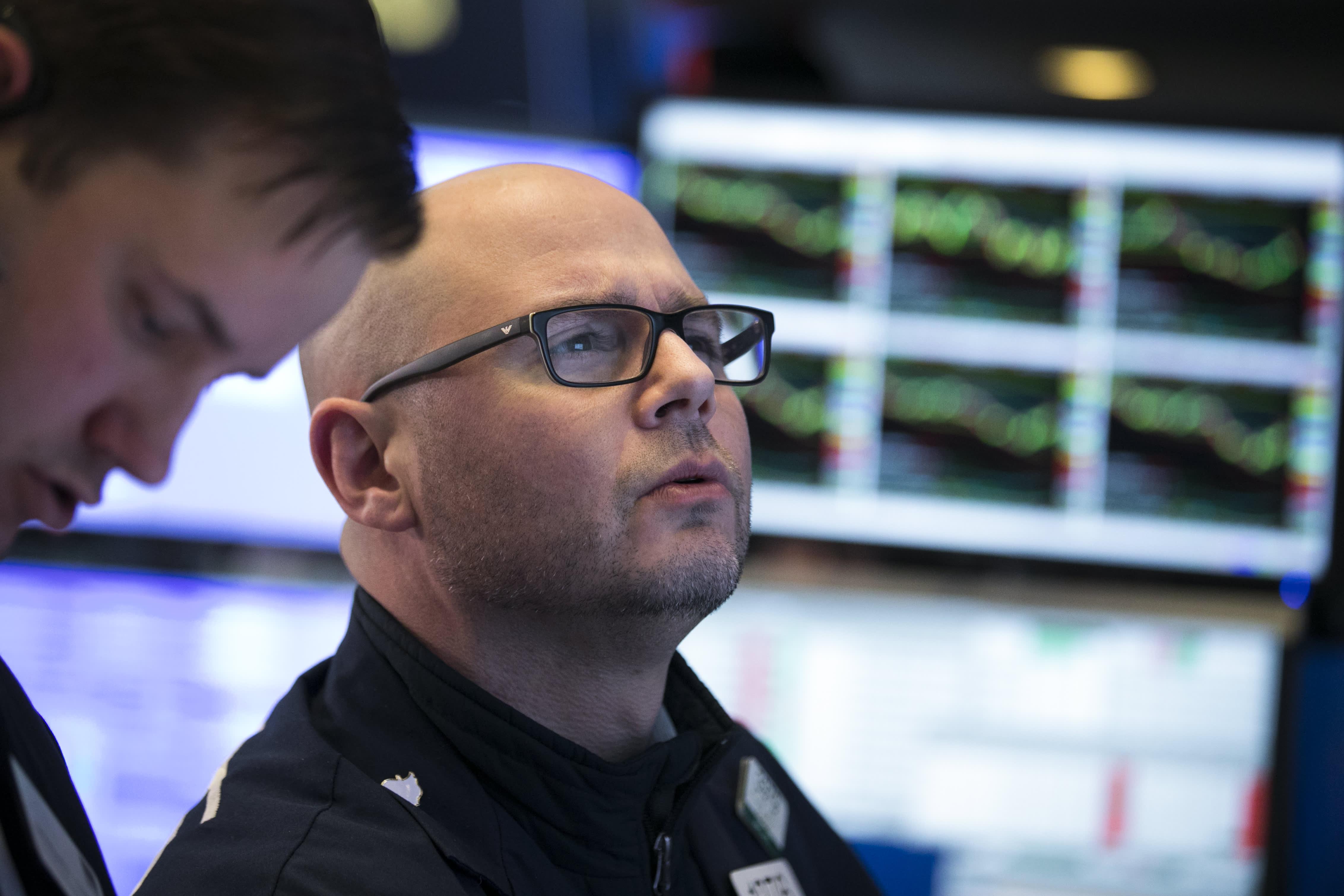 Stocks making the biggest moves premarket: CVS Health, Garmin, Gannett, Apple & more