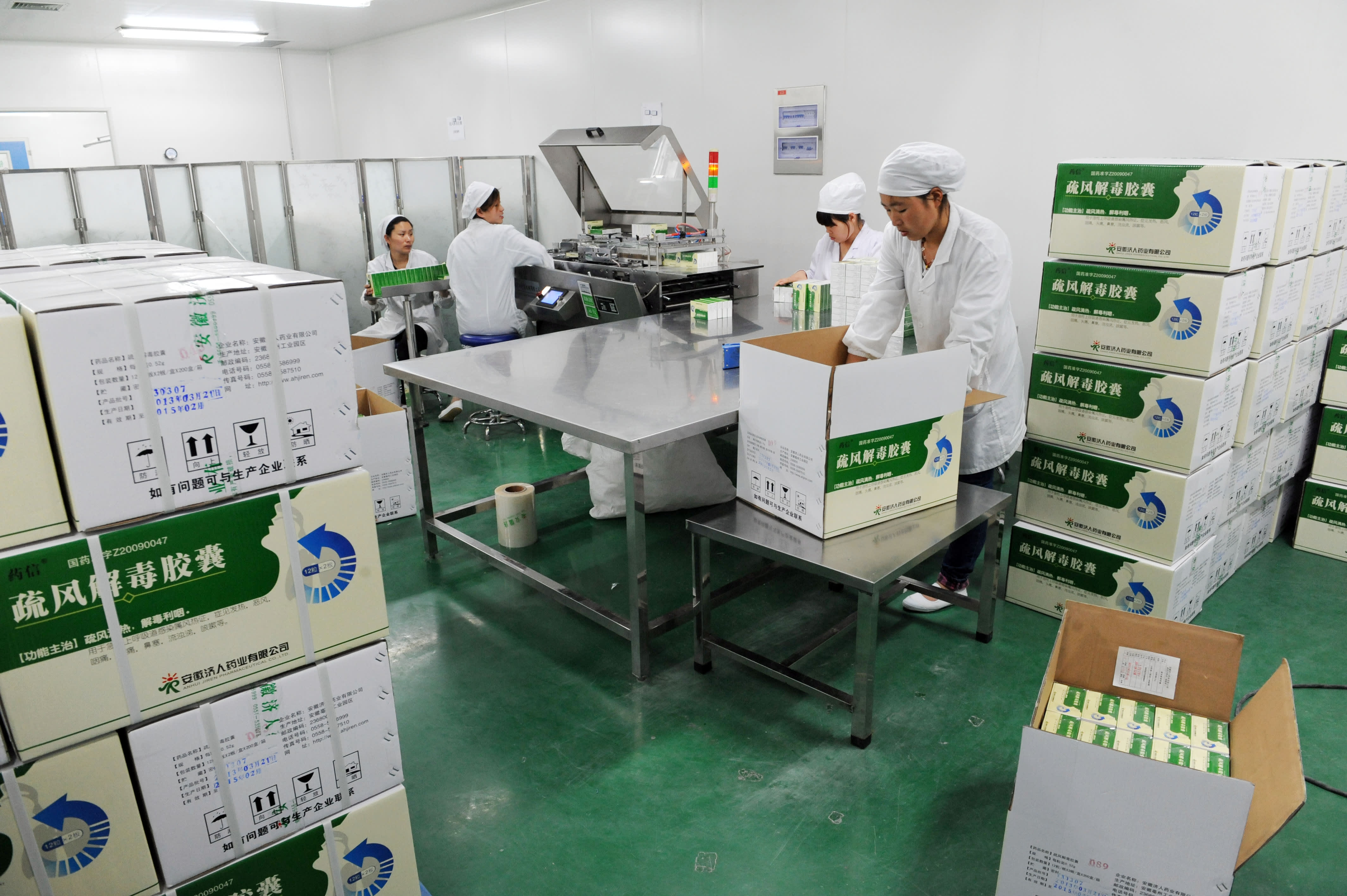 Employees work on the production line of Shufeng Jiedu Capsule, a Herbal Medicine for treating avian influenza patients, at a workshop of Anhui Jiren Pharmaceutical Co., Ltd on April 8, 2013 in Bozhou, China.