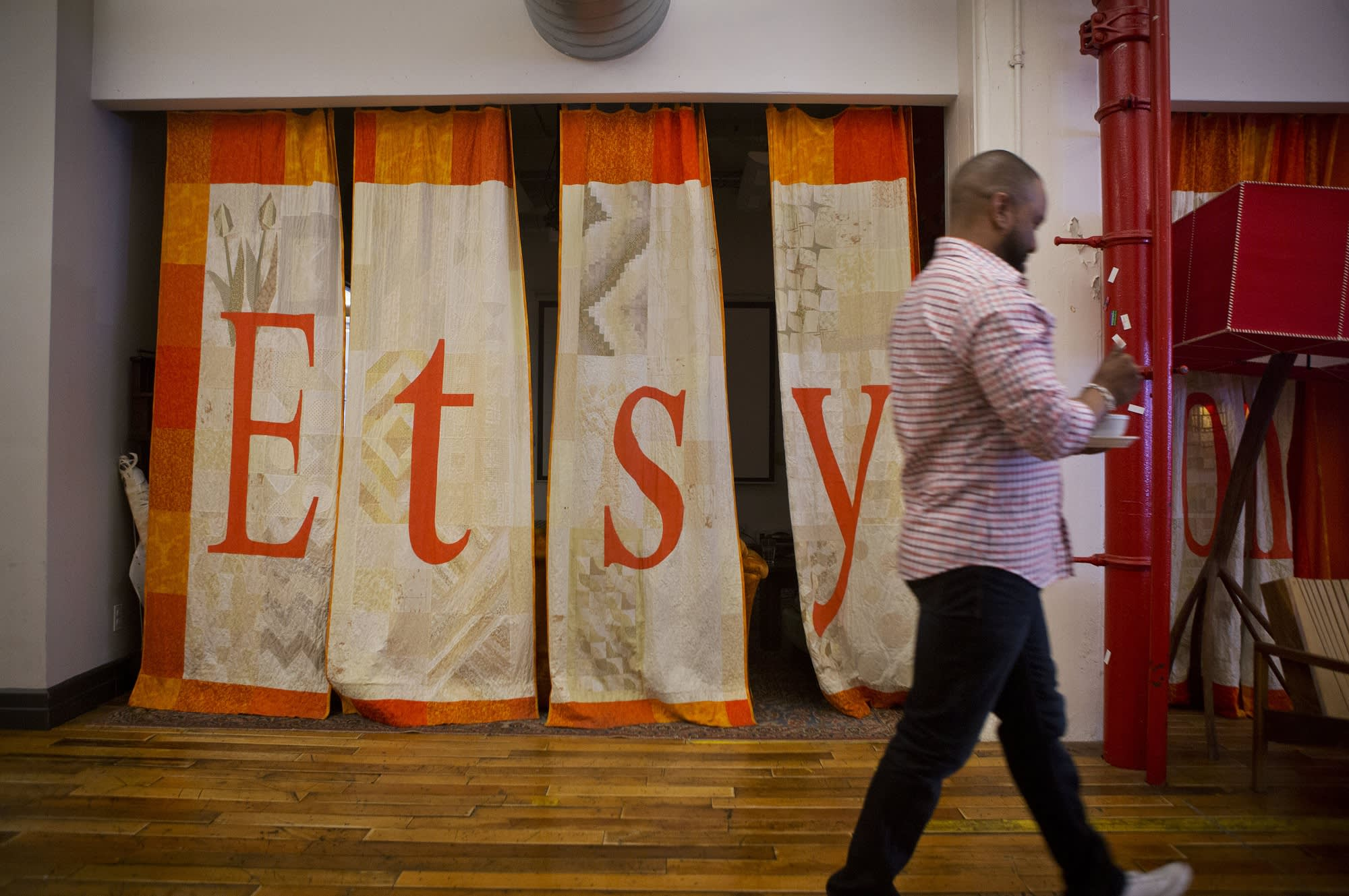 Etsy slides more than 9% after it warns of slowing growth