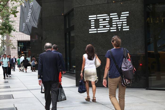 CNBC: IBM pedestrians pass by 151028
