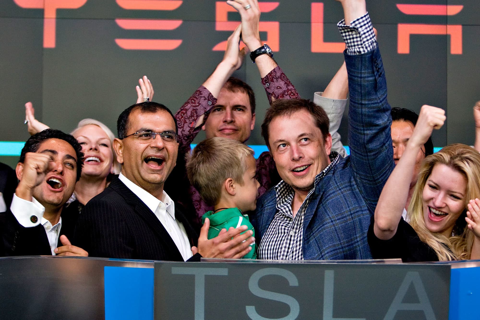 Deepak Ahuja, Tesla CFO (left) and Elon Musk, Tesla founder and CEO (right), at the Nasdaq opening bell ceremony for the Tesla initial public offering on Tuesday, June 29, 2010.