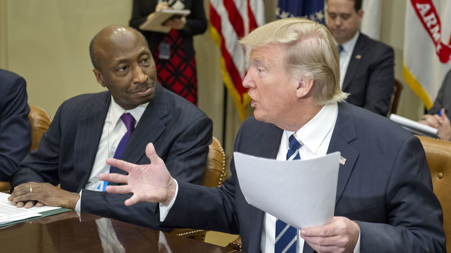 President Donald Trump, right, speaks as Ken Frazier, chairman and chief executive officer of Merck & Co., listens during a meeting with representatives from the Pharmaceutical Research and Manufacturers of America (PhRMA) at the White House in Washington, D.C., U.S., on Tuesday, Jan. 31, 2017.