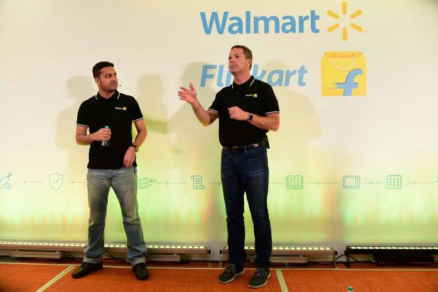 7be490808 Premium  Walmart CEO Doug McMillon (R) speaking next to Flipkart co-founder