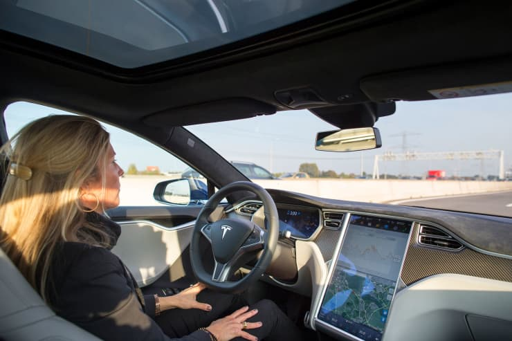 Premium: Tesla Auto pilot woman in driver's seat