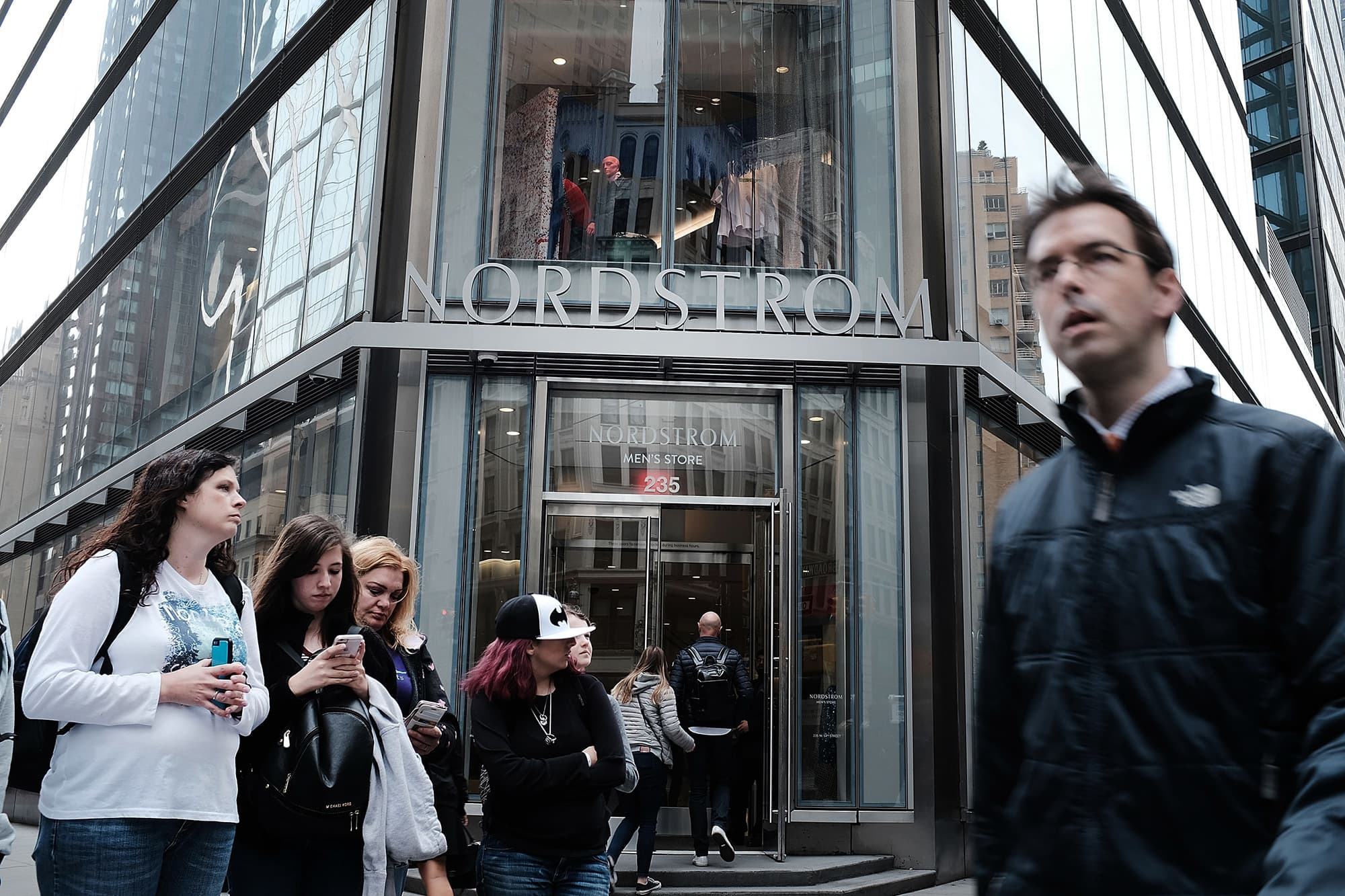 People walk by the Nordstrom men's store, the company's first-ever Manhattan location in midtown at 57th and Broadway on April 12, 2018 in New York City.