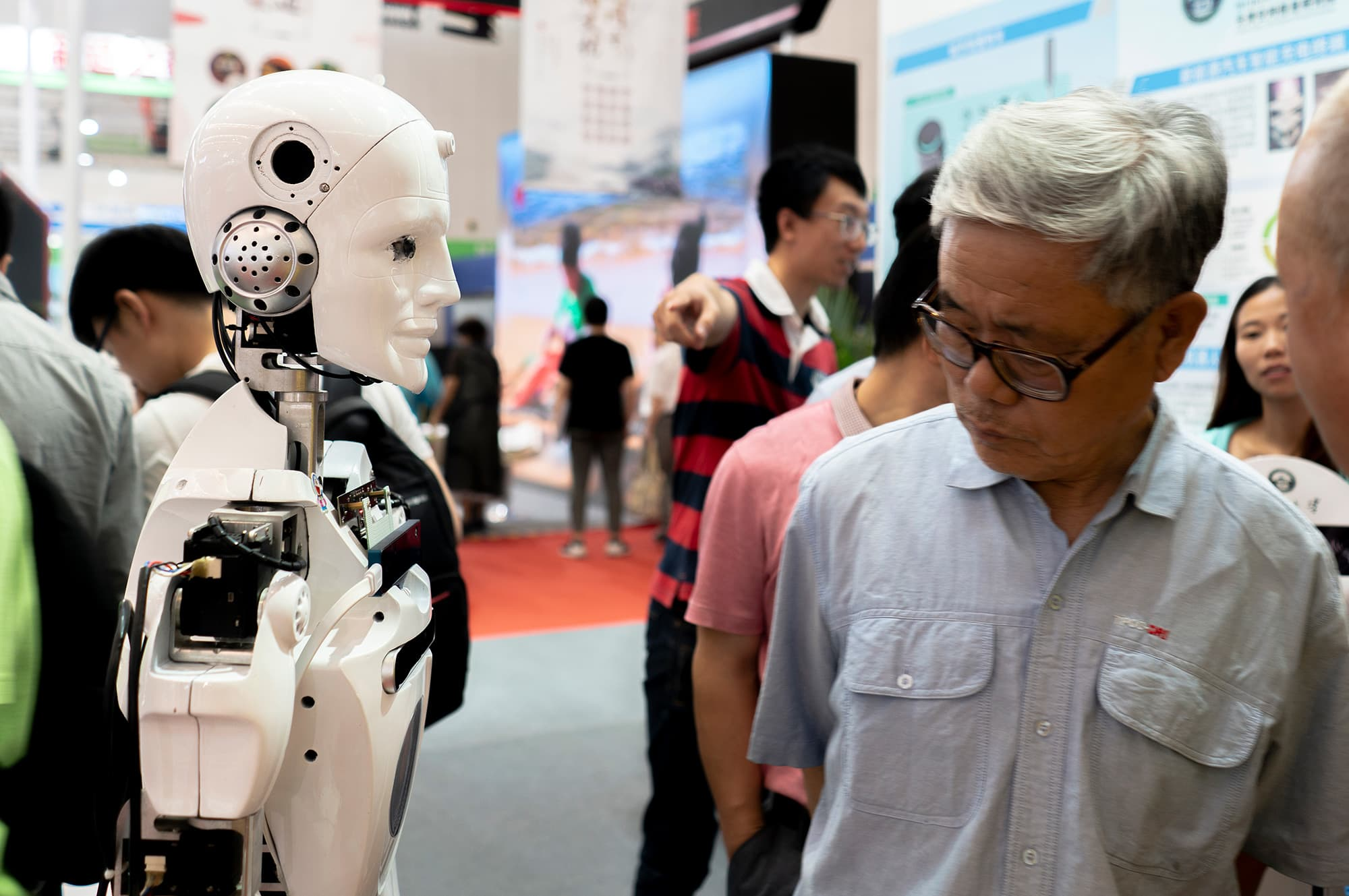 People are communicating with robots on the 2nd World Intelligence Congress, which was held in Tianjin Meijiang Exhibition Center from May 16-18, 2018.